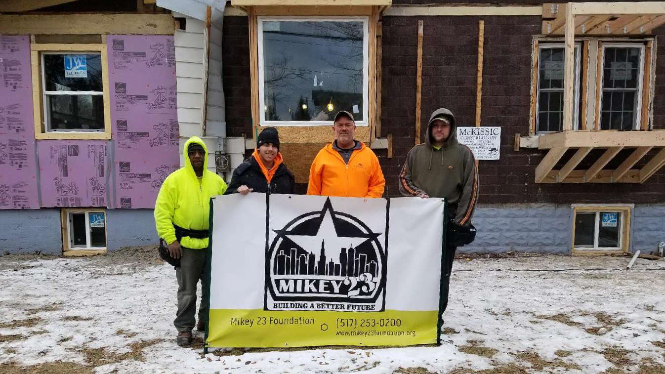 Consolidated Electrical Contractors team standing in front of Mikey23 Foundation house they wired